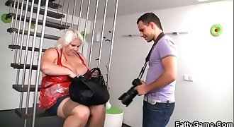Blonde fatty gives titjob to a photographer